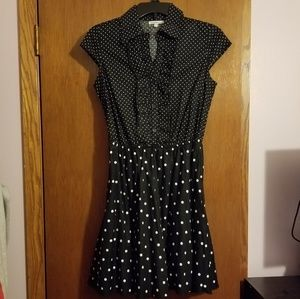 Black and white polka dot dress with red belt